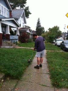John using weed wacker during hale storm